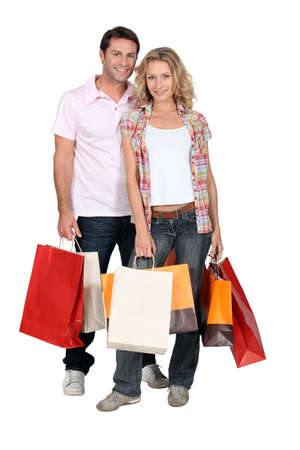 blonde couple: Couple with shopping bags Stock Photo