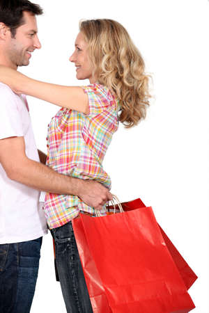 accomplices: couple with shopping bags