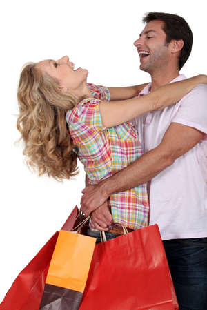 elated: An elated couple embracing Stock Photo