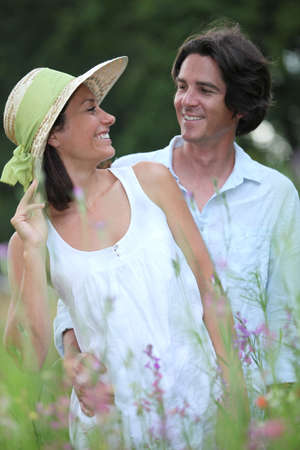dark haired: portrait of a couple outdoors Stock Photo