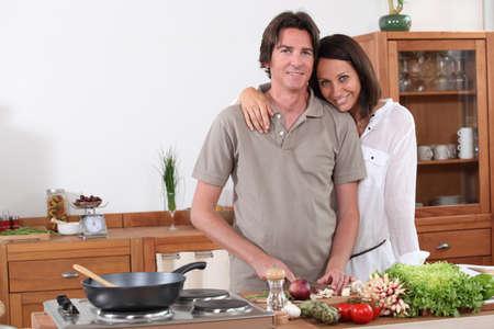 Couple preparing dinner in the kitchen photo