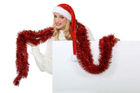 Mrs Santa using a tinsel as a scarf. Stock Photo - 11774997