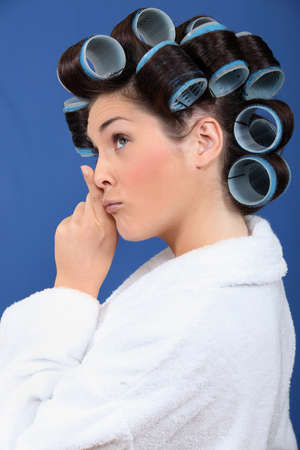 Woman with her hair in rollers photo