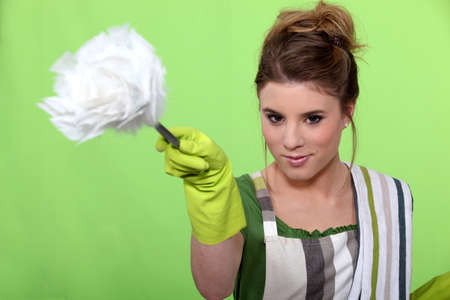 disinfect: Young woman dusting