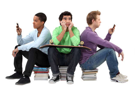 revising: Three male teenagers