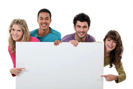 advertisements: happy foursome showing copyspace Stock Photo