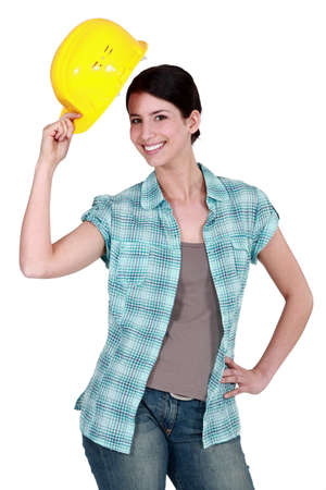aplomb: Woman tipping her hard hat