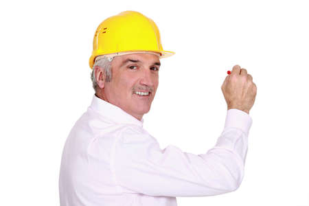 grey haired: Grey haired architect with pen Stock Photo