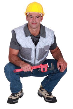 class maintenance: A male plumber.