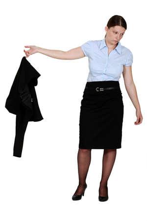 pantyhose: Frumpy businesswoman taking off her blazer Stock Photo