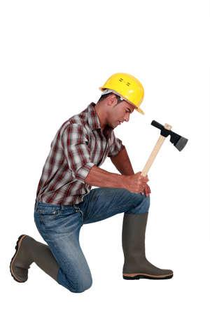 Tradesman using an axe photo