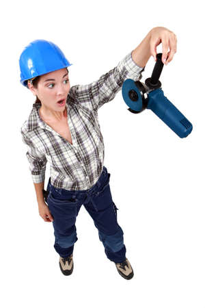 Woman holding an angle grinder photo