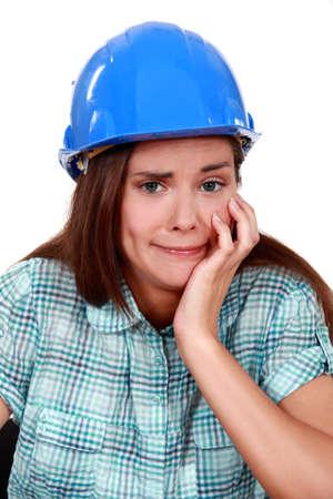aggravated: Woman entrepreneur grimacing