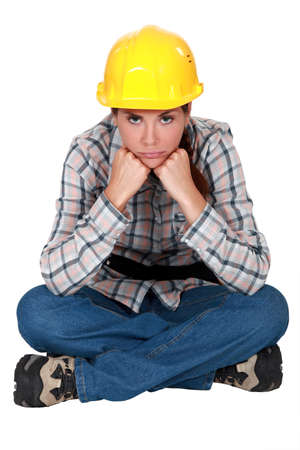 hard look: Gloomy female construction worker