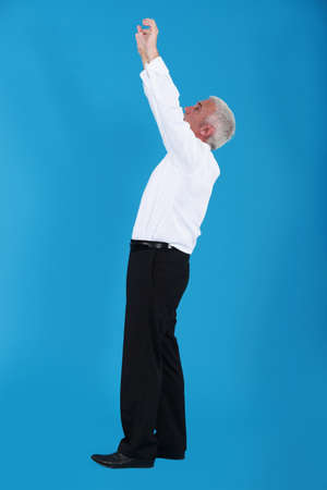 Businessman reaching up Stock Photo - 11774715