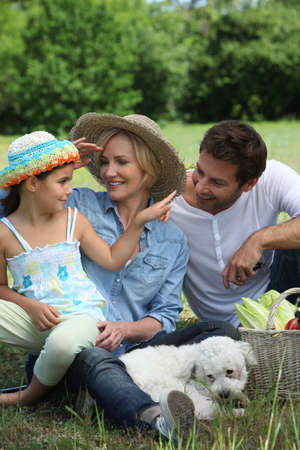 Family outdoors with their dog