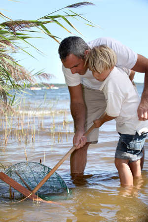 fishnet: Father and son fishing together Stock Photo