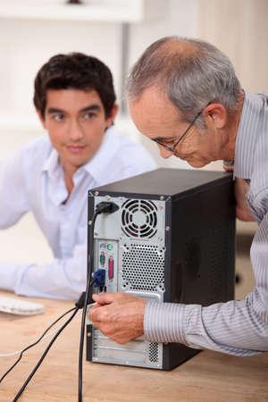 senior technician repairing computer photo