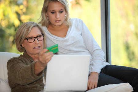 carte: Elderly woman using a card online