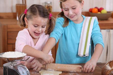 two little girls making pancakes Stock Photo - 11775797