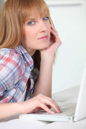 ginger haired: Ginger haired woman with laptop