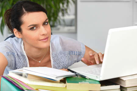 thesis: a woman doing computer Stock Photo