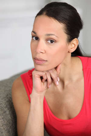 Young woman resting her hand on her chin Stock Photo - 11775796