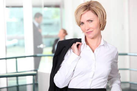 sexy mature women: businesswoman in the office Stock Photo