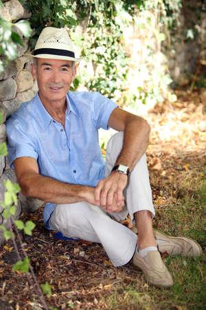 65 70 years: Elderly man relaxing in his garden