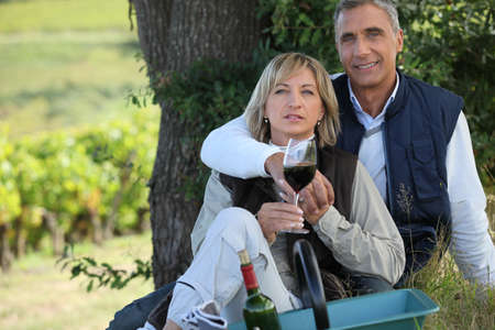 couple on a romantic picnic in a vineyard photo