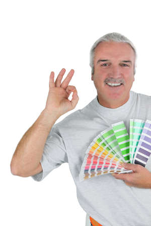 jumpsuite: a man taking paint sample cards Stock Photo
