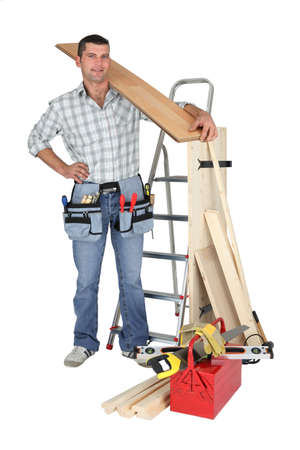 craftsman holding a wooden floor board photo