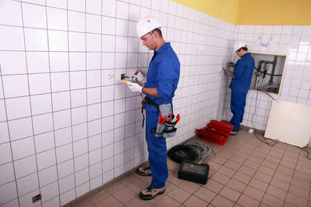 jumpsuite: electricians working