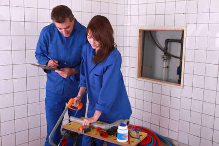 inexperienced: A team of plumbers at work