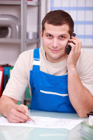 Craftsman: Technician on phone in office Stock Photo