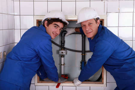 jumpsuite: two plumbers resting after work