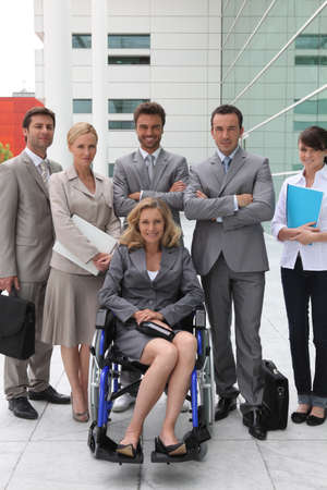 wheelchair access: woman in a wheelchair and team Stock Photo