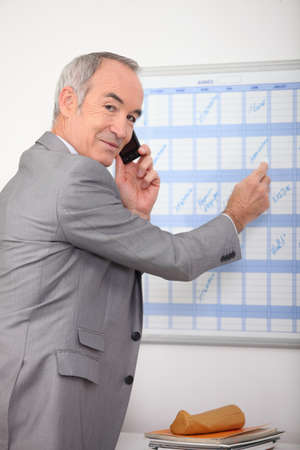 receded: businessman making a call