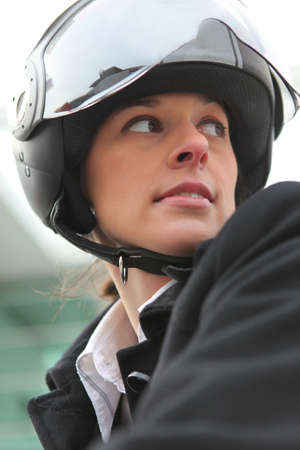 Businesswoman on a scooter photo