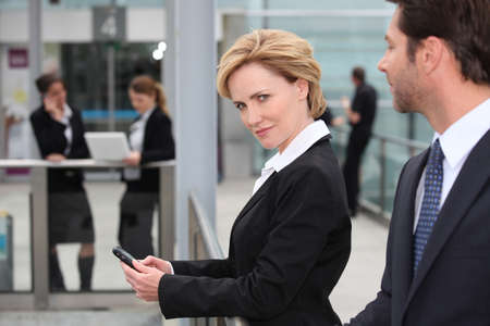 Businesswoman texting photo