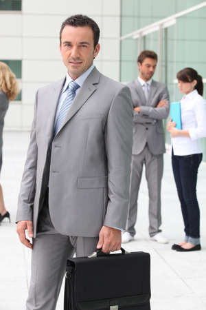 Man with briefcase outside office building Stock Photo - 11796216