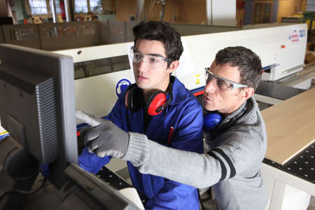 anti noise: young apprentice in industry sector with tutor Stock Photo