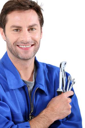 fontanero: El hombre con llaves Foto de archivo