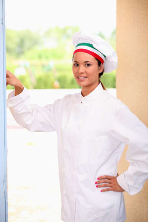 Chef ringing doorbell photo