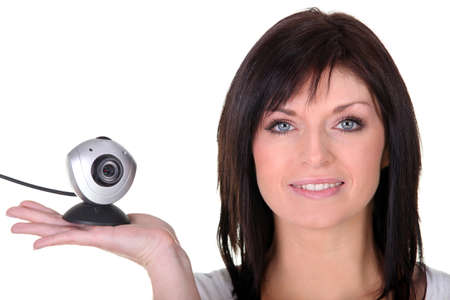 Woman holding web cam photo