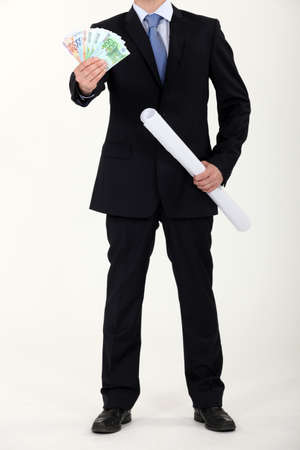 Businessman with architectural plans and a fistful of Euros Stock Photo - 11797604