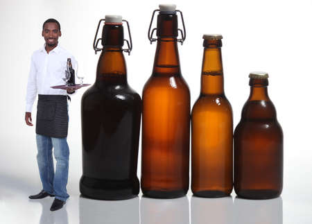 Waiter with beer bottles photo