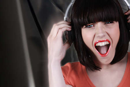 brunette wearing headset shouting photo