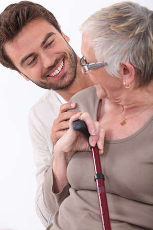 60 65 years: portrait of a young man and older woman Stock Photo