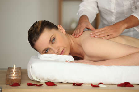 Relaxed woman having back massage photo